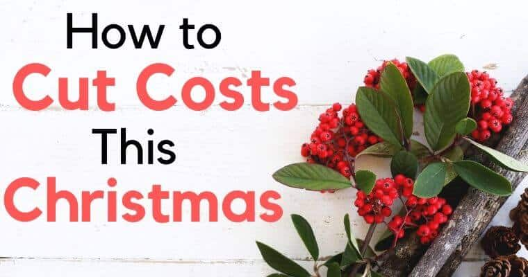 christmas berries with greenery on white table with text how to cut costs this christmas
