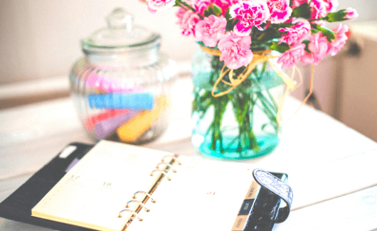 way to be an organized mom with planner on desk