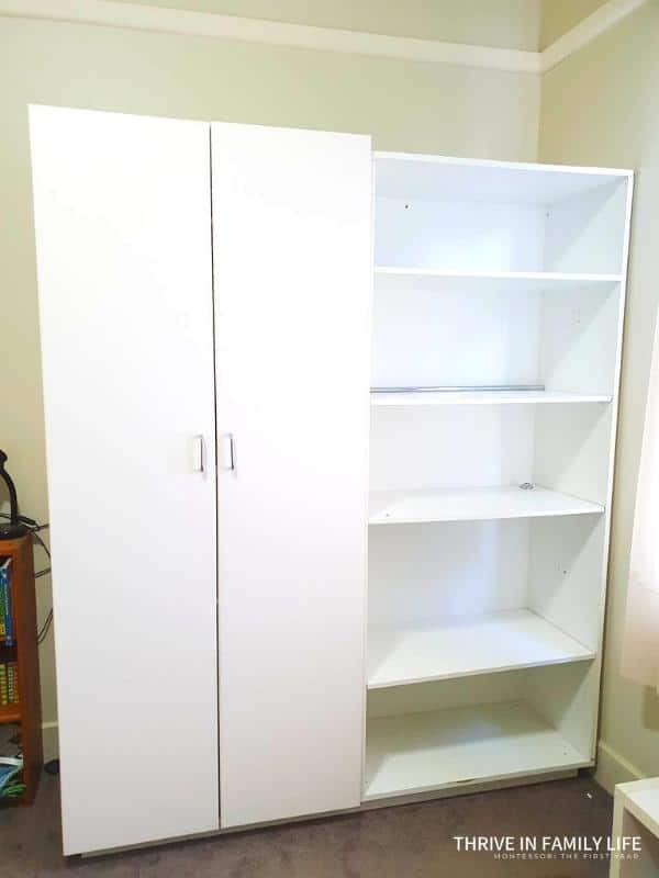 A tall while wardrobe with two doors on the left and open shelves on the right. Equal size for both sections.