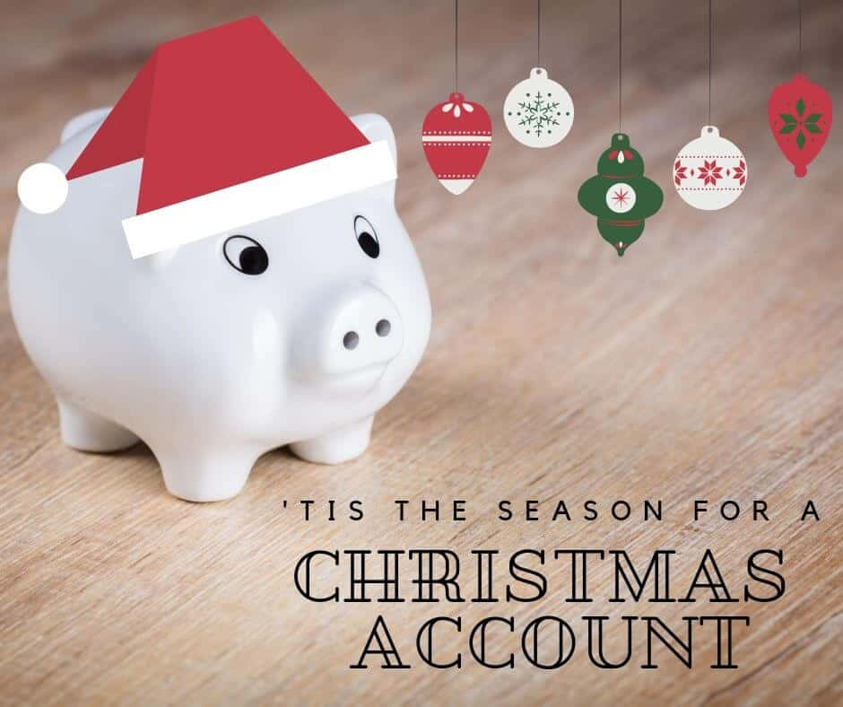 Christmas account white piggy bank on wooden table for Christmas saving