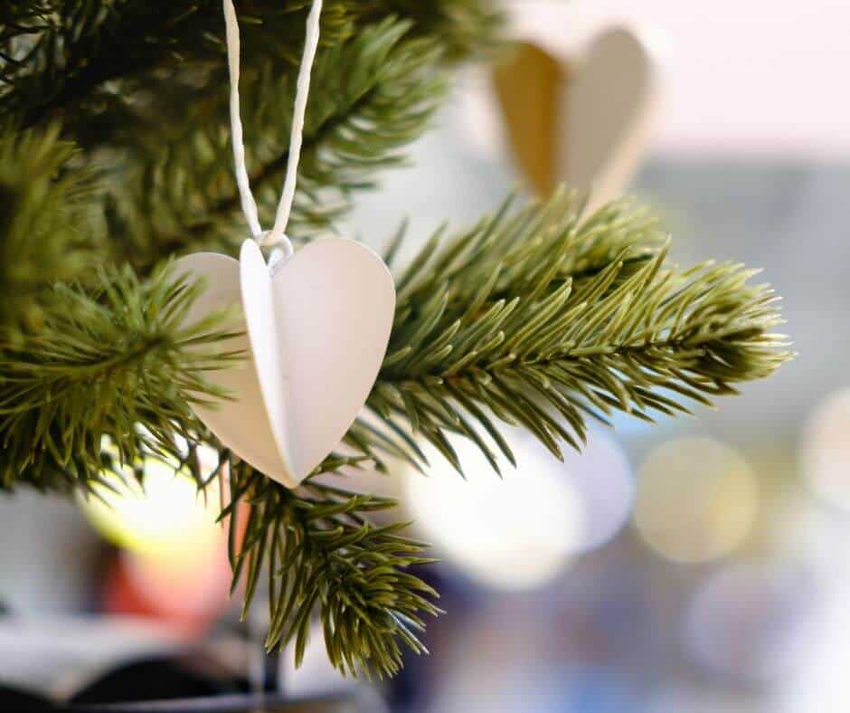 diy white heart ornament on christmas tree to cut costs of Christmas