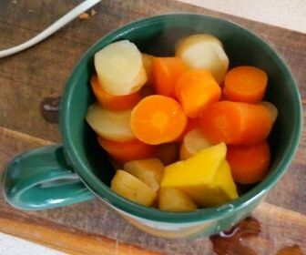 boiled carrots and parsnips in mug for baby food