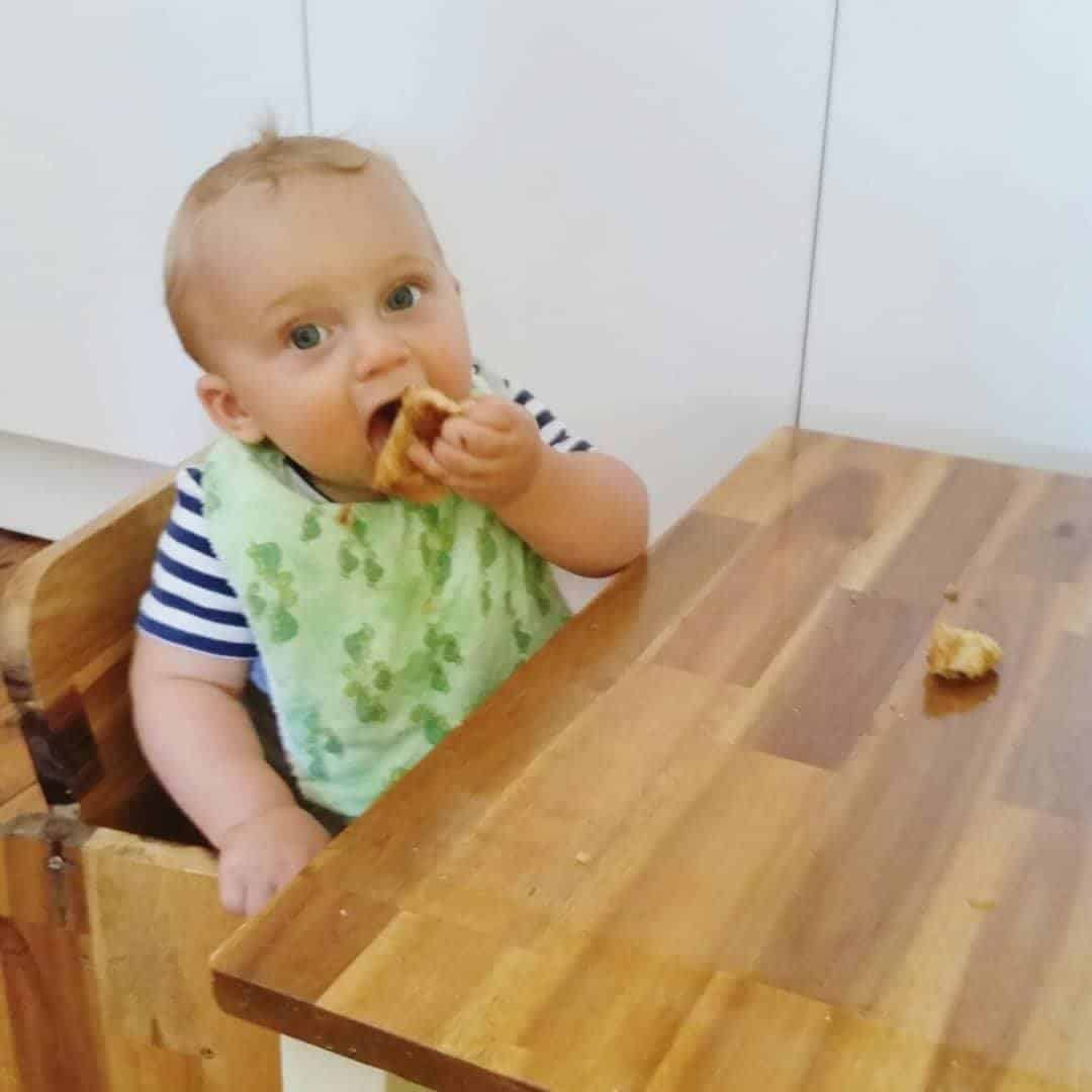 Montessori weaning table being used by 6 month old for breakfast