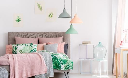 make bed as a positive morning task for sahm moms with pink,green,and grey bedding in bedroom with same color lamps