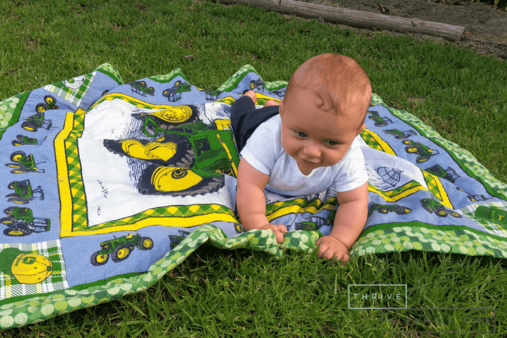 Montessori outdoor play with our 6 month old on a blanket in the backyard