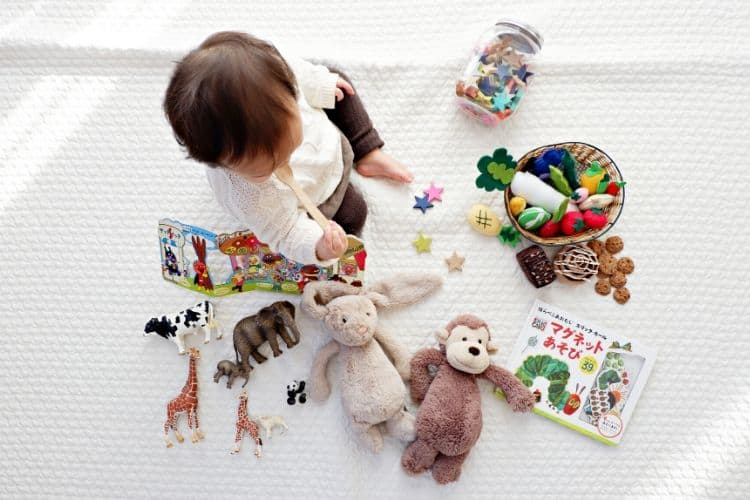 montessori 6 month old in play area with montessori toys