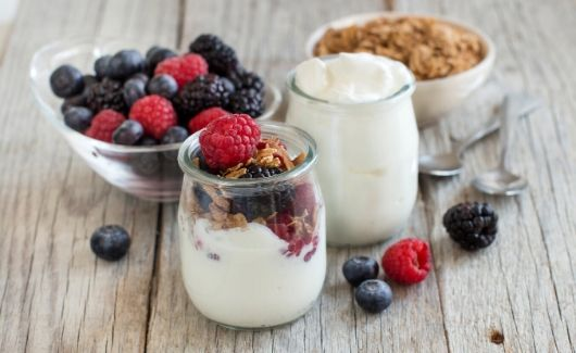 muesli and berries with yogurt in a cup for breakfast meal plan