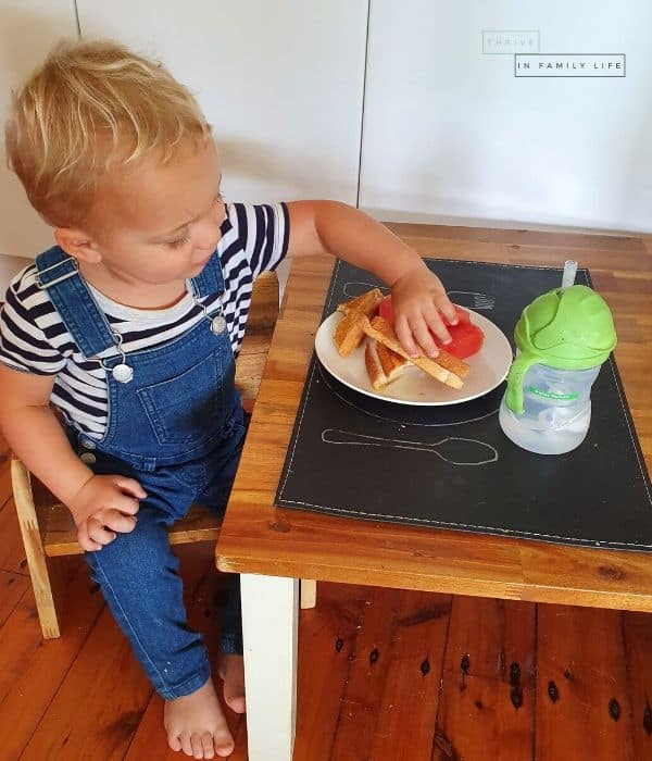 Montessori weaning table being used by 19 month old for lunch