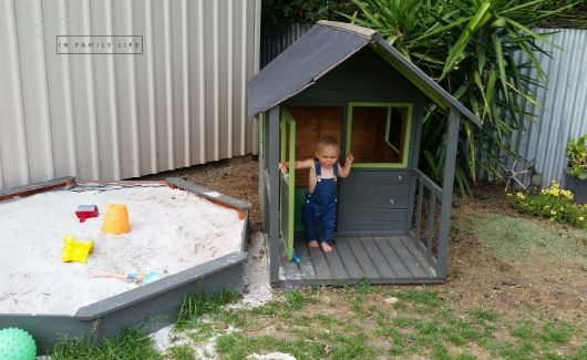 outdoor play area with cubby house and sandpit for 1 year old