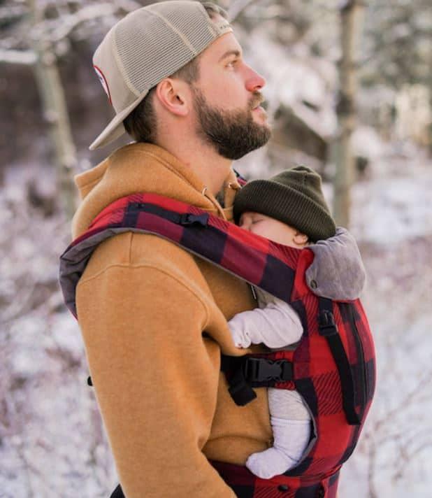 dad babywearing newborn in winter snow