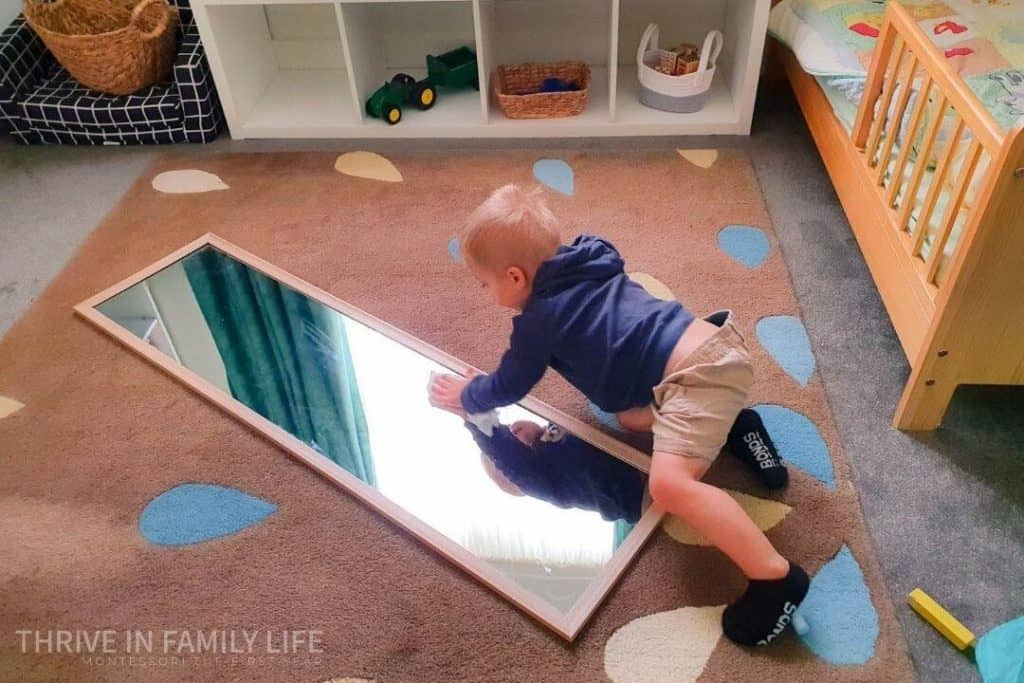 Montessori work for 2 year old wiping floor mirror