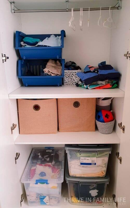 Montessori toy storage for 2 year old clothes and toys.