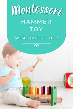 Montessori hammering toy in front of a baby sitting up on the floor.