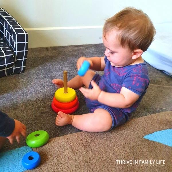 Montessori 8 months old boy with stacking rings